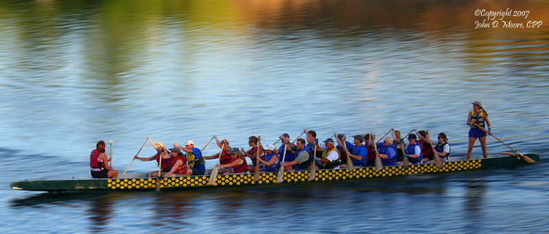 At sunset, a boat race on the Spokane River.