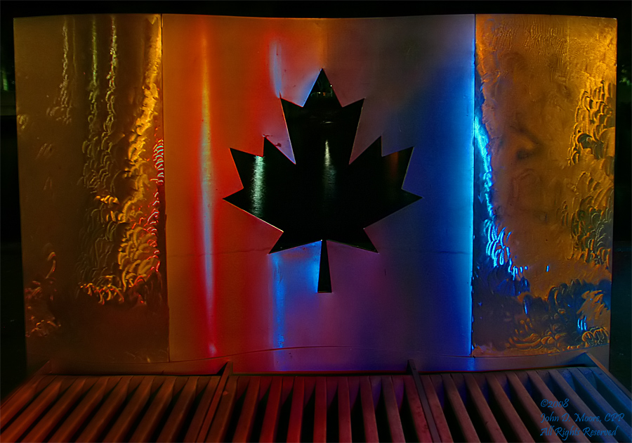 A stainless steel sculpture of the Canadian flag.
