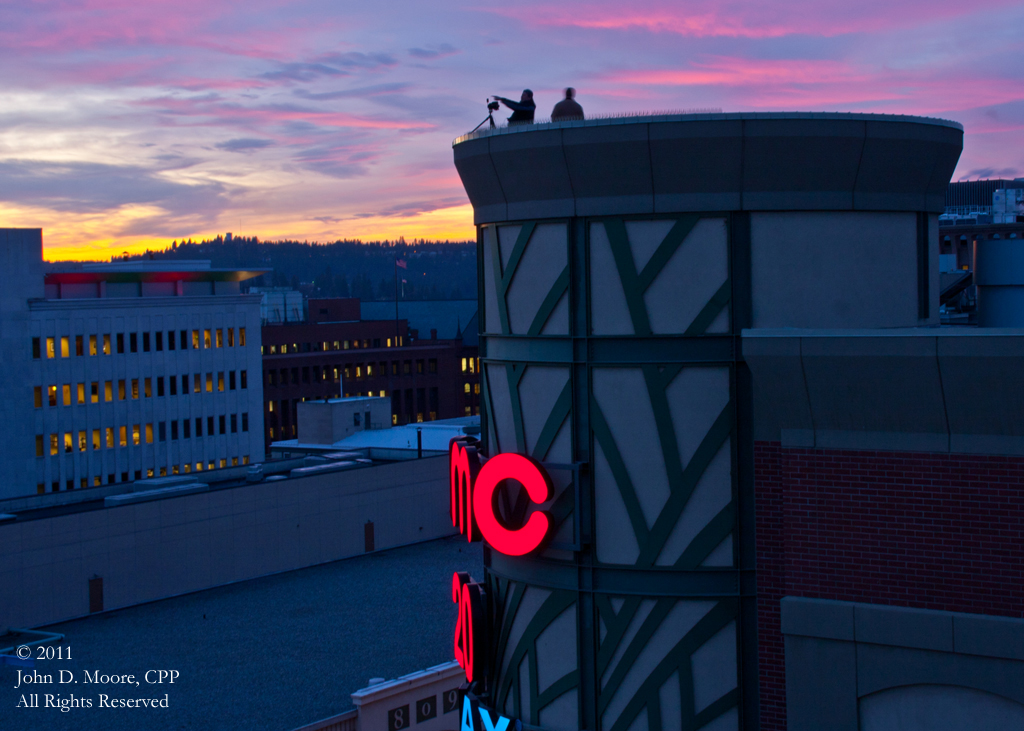 Photographers Chris Thompson and Eric Strate on the rooftop of the Riverpark Square Mall.