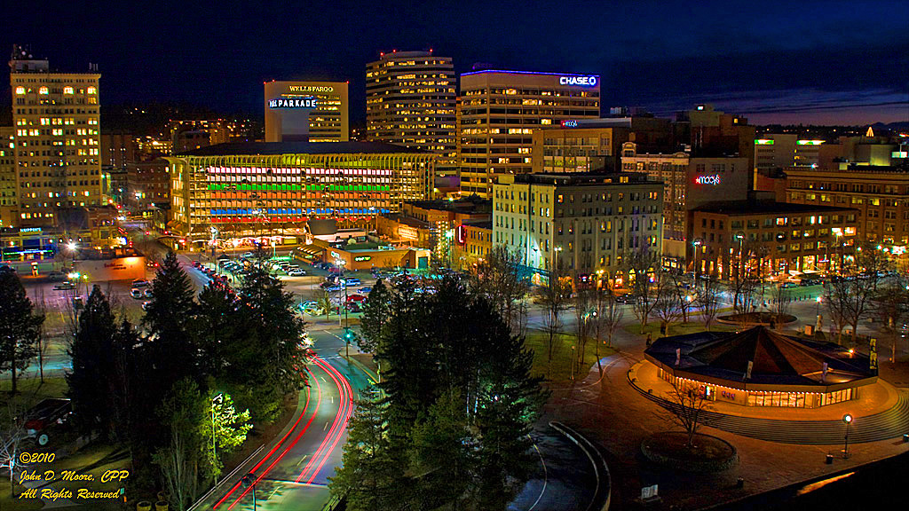 A view into downtown Spokane, shot from the top of Spokane's Riverfront Park Clocktower.  The Parkade is the very colorful parking structure in the center of the image.  Spokane, Washington.