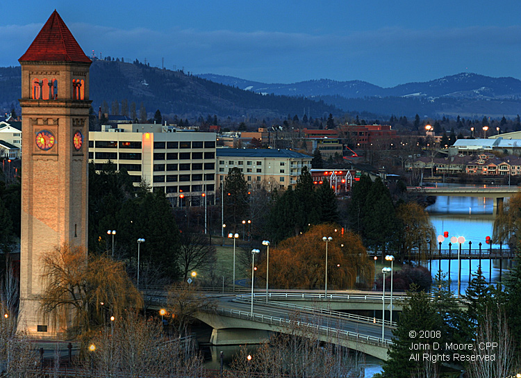 In Spokane's Riverfront Park, daylight transitions into darkness.