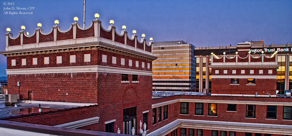 As the lights turn on, on top of Spokane's Davenport Hotel