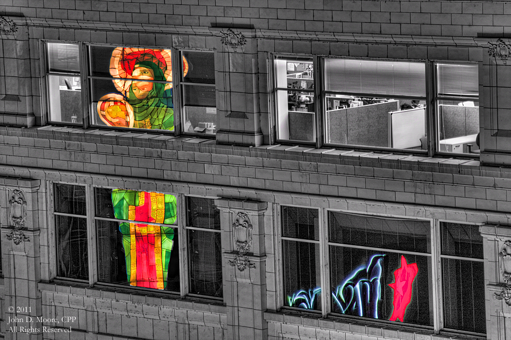 The Macy's reflections in the windows of the Crescent building in downtown  Spokane