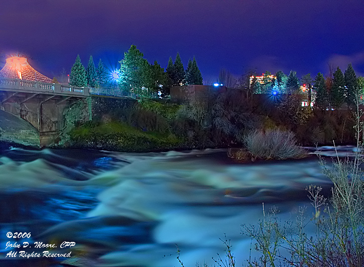 North river channel,  with a swollen Spokane River, Spokane, Washington
