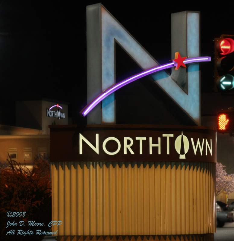 Spokane streetlights pointing the way to Northtown Shopping Center.