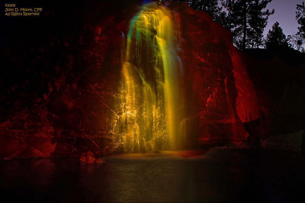 The Mirabeau park waterfall in total darkness, in the city of Spokane Valley.
